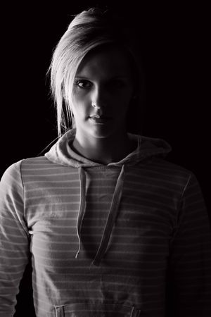 hooded top: Low Key Shot of a Pretty Blonde Girl in Striped Hooded Top Stock Photo