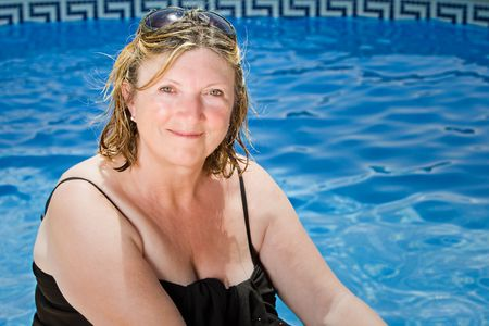 sarong: Shot of a Senior Lady Sitting by the Pool