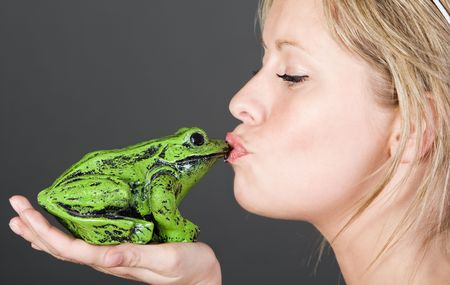 Shot of a Stunning Blonde Girl Kissing a Frog