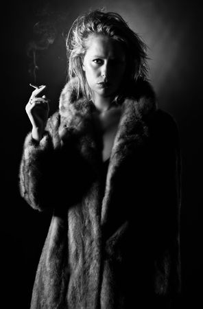 Black and White Shot of a Vintage Styled Woman Holding a Cigarette photo