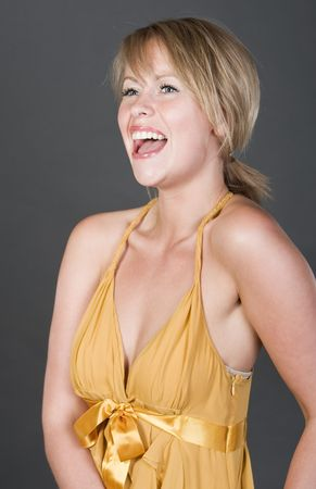 Shot of a Beautiful Blonde Girl in Golden Dress Laughing Stock Photo - 4854724