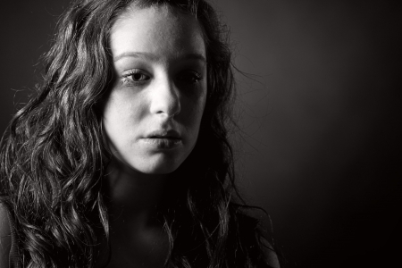 english girl: Powerful Black and White Shot of a Tearful Teenager