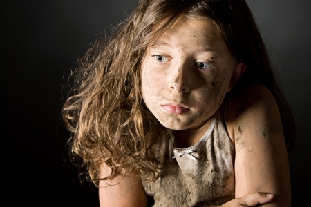 muddy: Low Key Shot of a Scared and Filthy Brown Haired Child