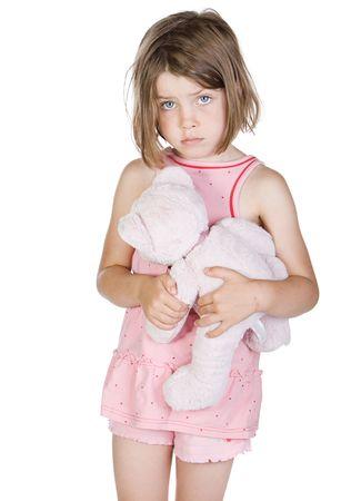 Shot of a Sad Blonde Child Holding her Teddy Bear photo