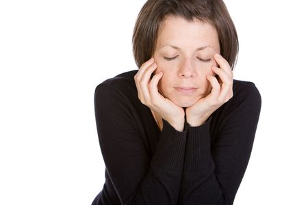 eyes shut: Isolated Shot of a Brunette with her Eyes Shut Stock Photo