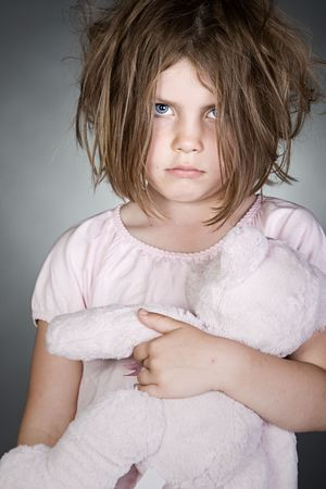 neglect: Shot of a Messy Upset Child Gripping her Teddy Bear