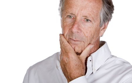 Close Up Shot of a Handsome Senior Man Looking Pensive against a White Background