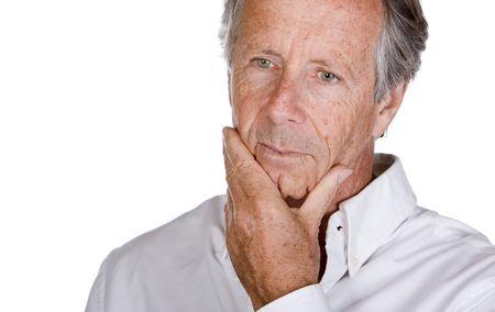 hombre preocupado: Plano corto de un hermoso Senior Hombre pensativo sobre un fondo blanco Foto de archivo