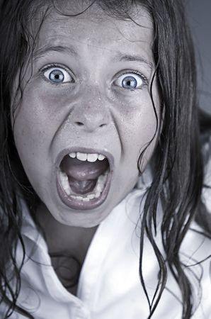 Close Up Shot of a Child Screaming photo
