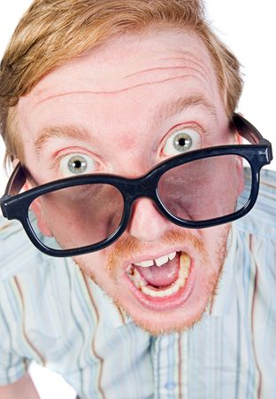 Shot of an Angry Red Headed Geek with Thick Rimmed Glasses Stock Photo - 5719861