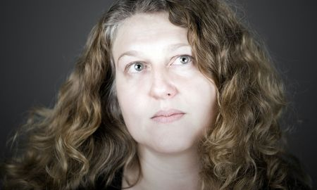 Shot of a Middle Aged Woman with Long Curly Hair photo