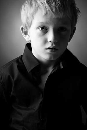 freckle: Low Key Shot of a Young Lad Looking Down