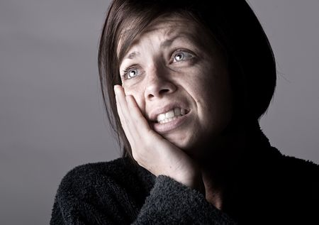 Shot of a Woman with Toothache against Grey Standard-Bild