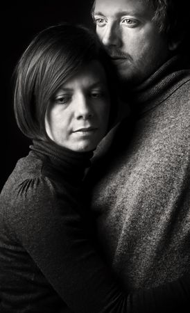 togther: Low Key Shot of a Couple Embracing Stock Photo