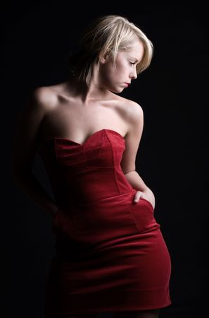 Low Key Shot of a Stunning Blonde Girl in Red Dress photo