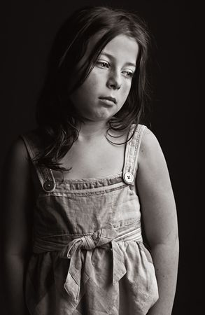 dungarees: Powerful Low Key Shot of an Upset Young Girl