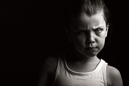 violencia domestica: Potente bajo shot de clave de un ni�o con actitud Foto de archivo