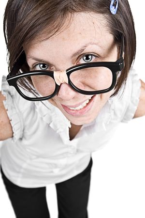 sneer: Shot of a Cute Nerdy Female in Thick Rimmed Glasses Stock Photo