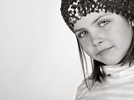 Shot of a Cute Child Looking into the Camera with Copyspace photo
