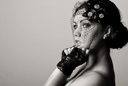 Stunning Black and White Shot of a Beautiful Teenage Girl in Veil against a Grey Background Stock Photo - 6352386