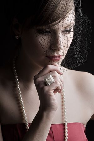 classy woman: Powerful Shot of a Beautiful Girl in Vintage Style Clothing Looking Down Stock Photo