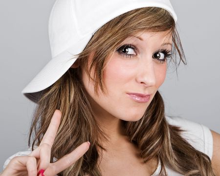 Close Up Shot of a Beautiful Teenager Girl in a White Baseball Cap Stock Photo - 6352427
