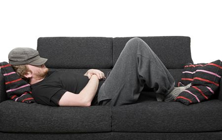 Shot of a Man Asleep on a Grey Sofa Stock Photo