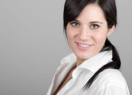 Shot of a Beautiful Dark Haired Girl Smiling into the Camera photo