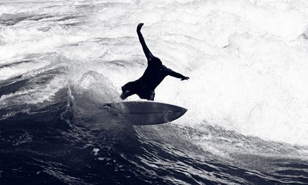 male surfer: Awesome Shot of a Surfer Riding the Waves Stock Photo