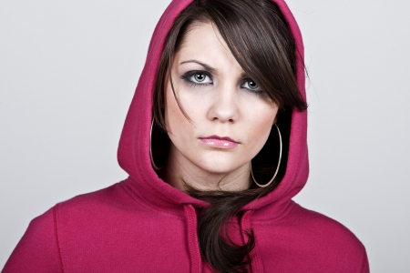 asbo: Shot of a Female Hoodie against Grey Background