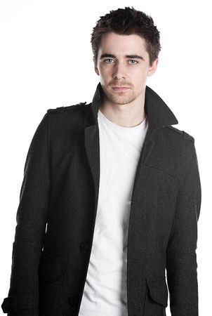 bloke: Fotografia di un bel maschio pelo scuro in giacca da isolato  Archivio Fotografico