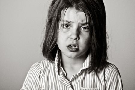 Powerful Black and White Shot of a Young Schoolgirl photo