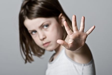 Powerful Shot of a Child with her Hand Up photo