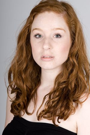 Shot of a Pretty Red Headed Teenage Girl with Freckles