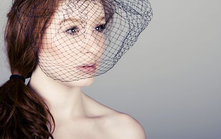 Powerful Shot of a Red Headed Teenager in Veil photo