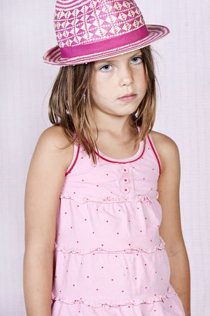 Shot of a Young Girl in Pink Attire against Pink Background photo