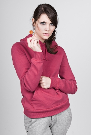 Teenage Girl in Hooded Top with Lollipop photo