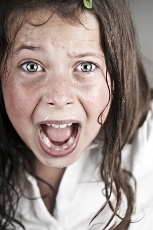 Shot of a Child Screaming at Camera photo