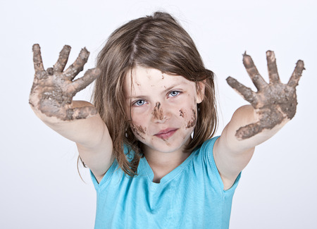 Shot of a Young Girl with Dirty Hands and Face photo