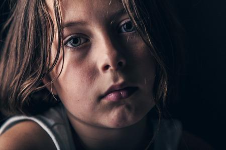 悲しい子の強力なショット 写真素材