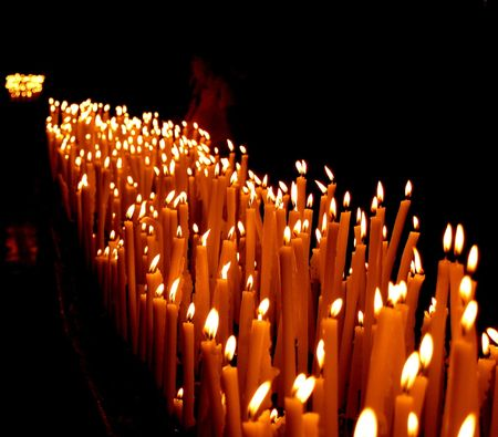 dark: candles in a church in Florence, Italy Stock Photo