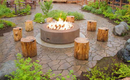 Fire pit with wood logs for seats around the fire pit