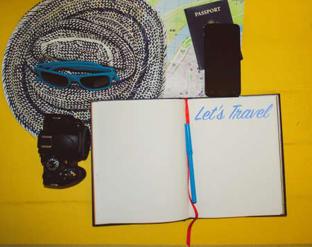 Items needing for traveling: notebook, passport, pen, paper, map, hat, camera, phone, sunglasses