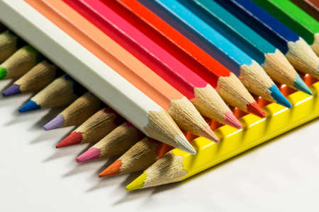 Two rows of colored pencils lying at right angles to each other