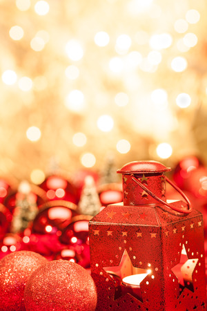 Red lantern and christmas balls with a golden background photo