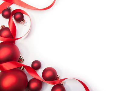 christmas decorations with white background: Christmas balls and a red ribbon on a white background Stock Photo