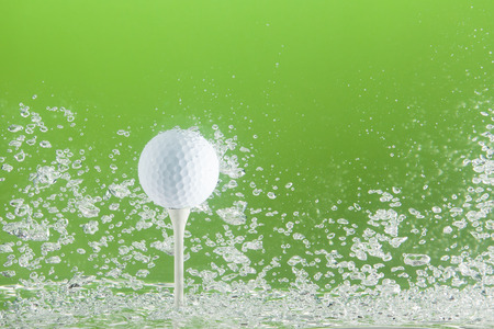 golfball: Golfball on a peg in water with bubbles Stock Photo