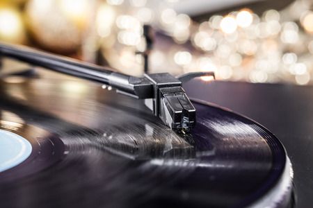 hi fi: Turntable where you see the pickup closely with shallow depth of field. Stock Photo