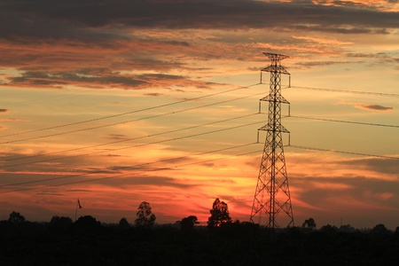 High-voltage towers Silhouette . photo
