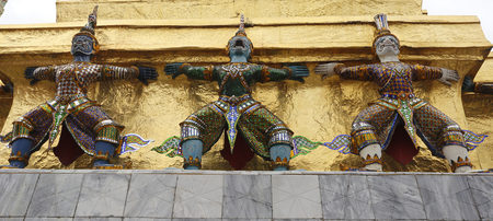 statuettes: Thailand. The Grand Palace. Temple of the Emerald Buddha. Gold ornamental patter statuettes.